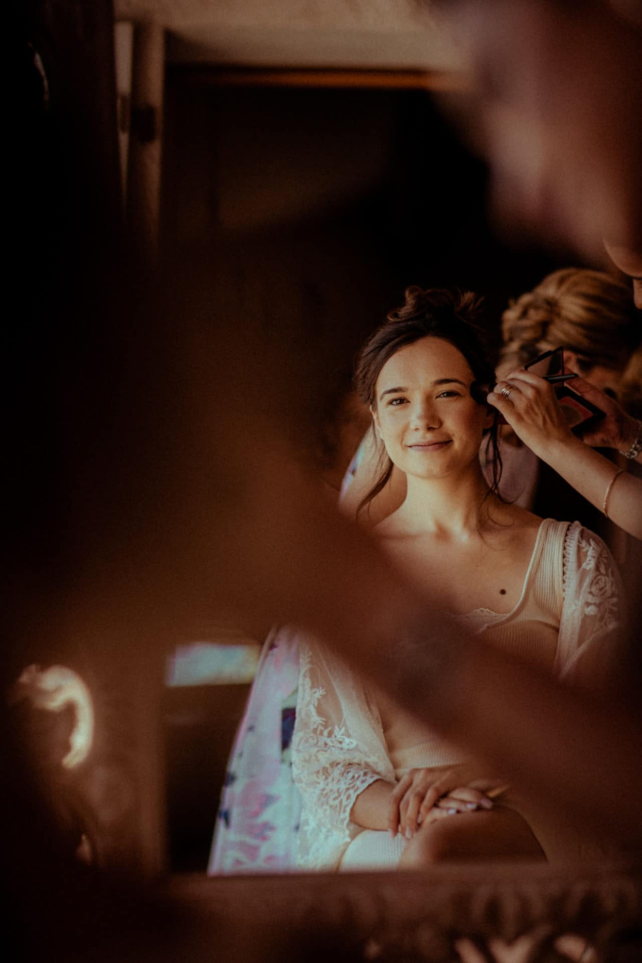 the bride smiling while preparation